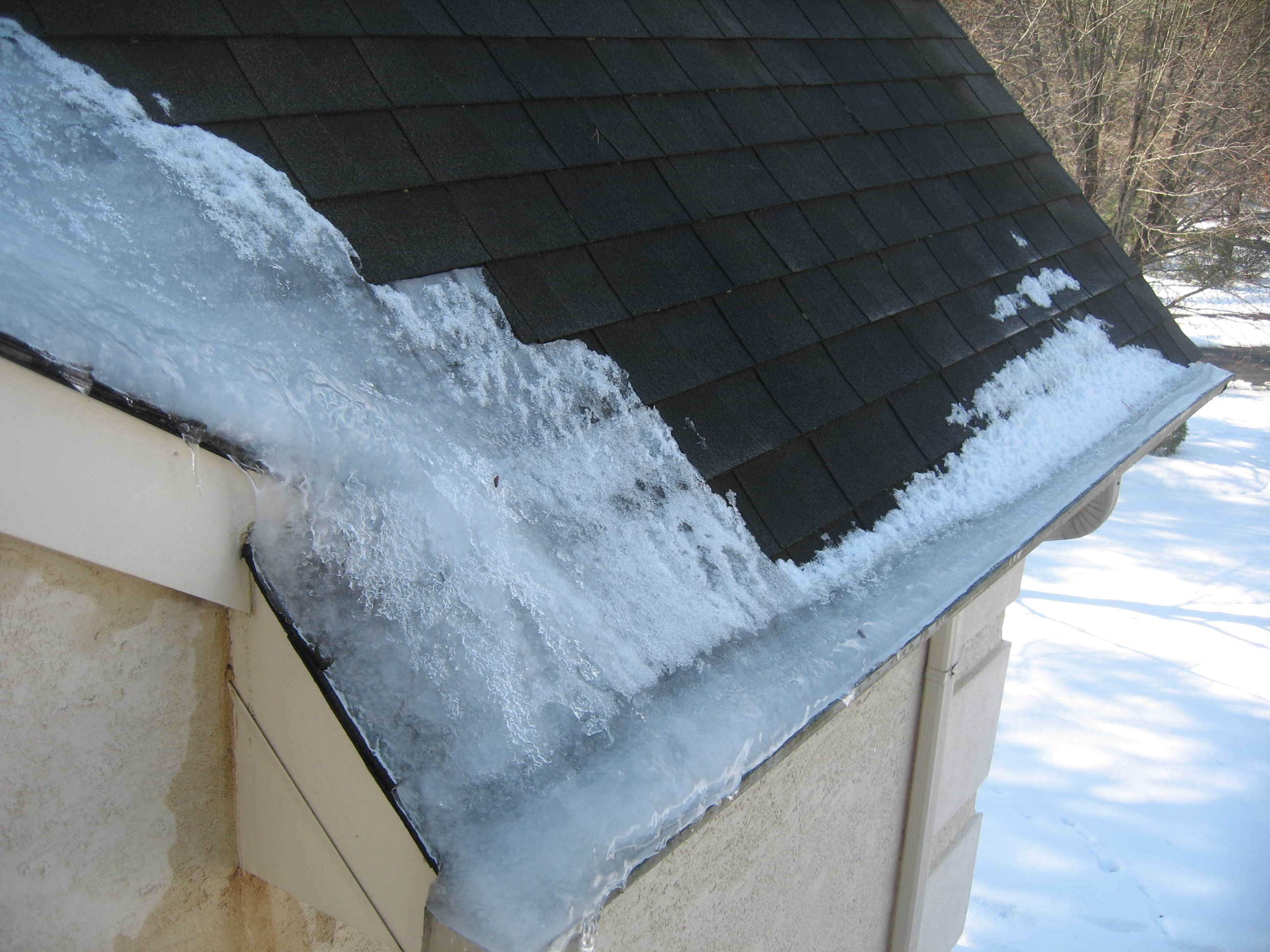 Winter damage roof leaks caused by ice damming south for Roof leaking in winter